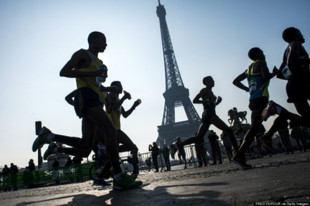 Competitors run past the Eiffel tower during the 37th edition of the Paris Marathon on April 7, 2013 in Paris. AFP PHOTO / FRED DUFOUR        (Photo credit should read FRED DUFOUR/AFP/Getty Images)